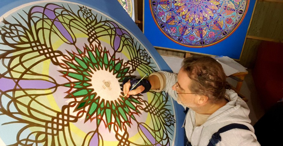 Mandala Artist at work 2019 amazing new Bluebell Mandala - studio photograph shows Stephen Meakin painting a new mandala.